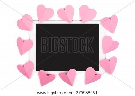 Pink Paper Hearts Framing Touchpad With Blank Screen Isolated On White