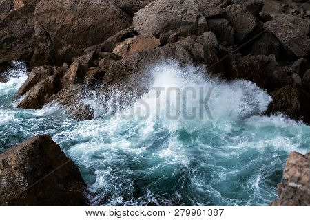 Save Download Preview Sea Waves Breaking On A Rocks. Deep Blue Sea Waves Hit Cliff, Hit Rocks Cliff.