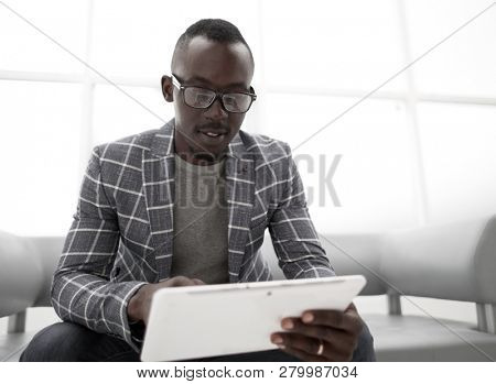 young businessman looking at digital tablet screen.