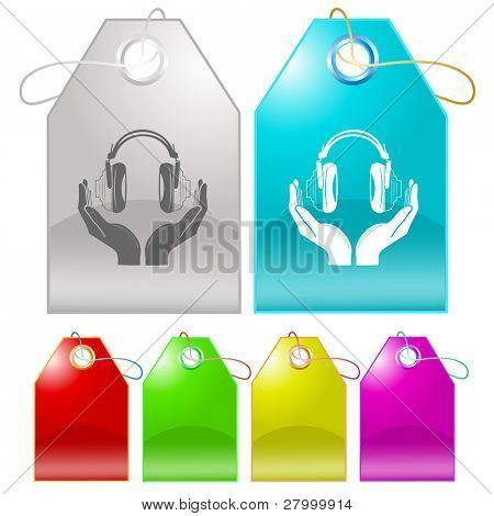 headphones in hands. Vector tags.