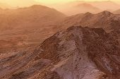 Beautiful landscape in the mountains at sunrise. Amazing view from Mount Sinai (Mount Horeb, Gabal Musa, Moses Mount). Sinai Peninsula of Egypt. Pilgrimage place and famous touristic destination. poster