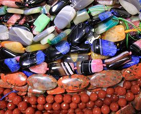 Colorful Necklaces Of Different Gems As A Natural Background