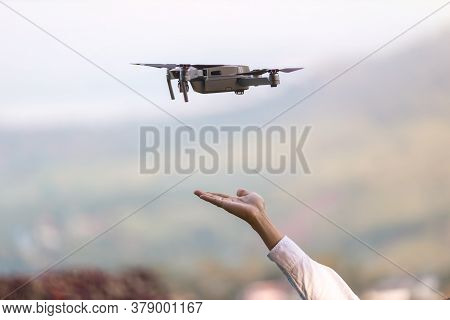 Drone Copter Flying With Digital Camera Near Hand.