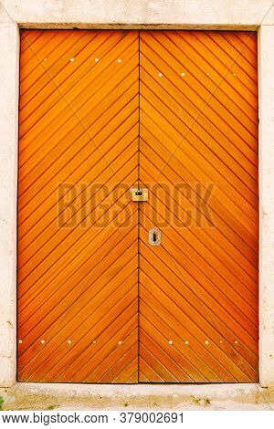 Bright Orange Striped Double Doors With Hardware.
