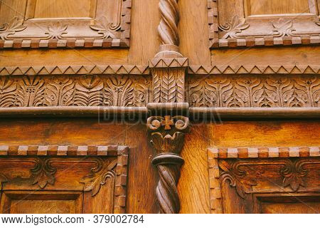 Close-up Texture Of Brown Doors With Raised Carvings And Patterns.