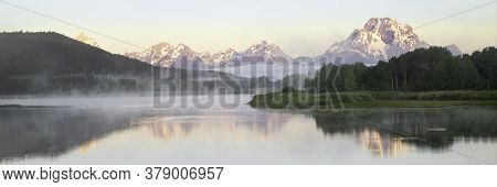 Fog Rolls In On The Snake River At Oxbow Bend At Sunrise. Oxbow Bend Is Located In Grand Teton Natio