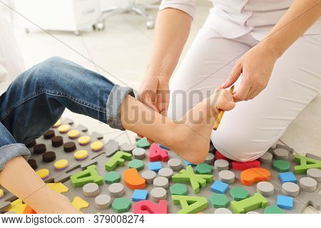 Child Flatfoot Treatment Using Special Massage Carpet.little Girl On Massage Mat Doing Exercises For