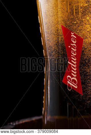 London, Uk - April 27, 2018: Original Glass Of Budweiser Original Beer On Top Of Old Wooden Barrel W