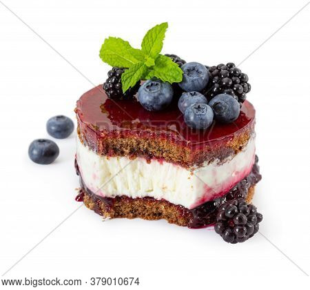 Cheesecake With Fresh Mint, Blueberries And Blackberries, Blueberry Jam And Jelly Isolated On White