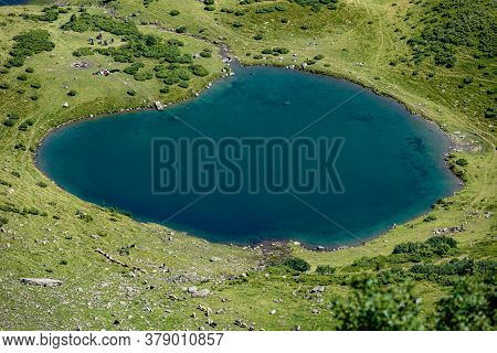 Aerial Top View Of Vorozheska Lake In Carpathian Mountains