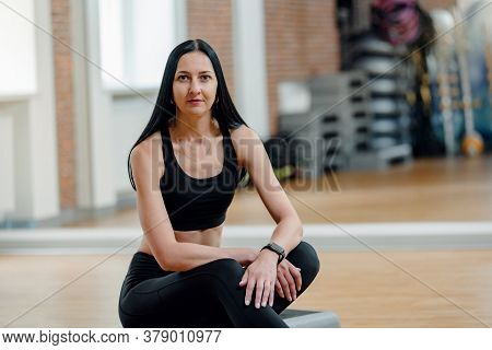 Young Attractive Girl Resting After Group Fitness Training In Gym