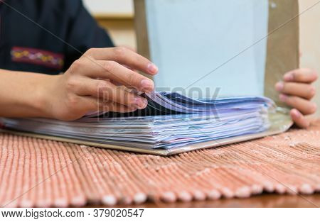 Businessman Reading In Paperwork Files In Binder And Checking Infomation Unfinished Documents About