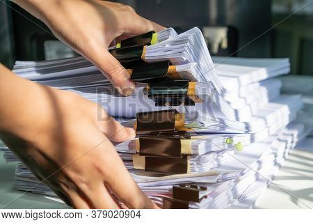 Businessman Working In Stacks Of Paperwork Files For Searching Infomation Unfinished Documents About
