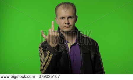 Rocker Man In Leather Jacket Showing Middle Finger, Demonstrating Protest Hate, Impolite Rude Gestur