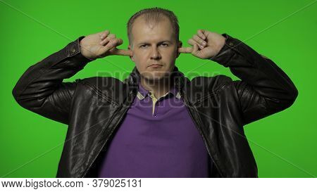 Dont Want To Listen. Upset Rocker Man In Brown Leather Jacket Covering Ears With Arms Not To Hear An