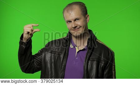 Positive Rocker Man In Brown Leather Jacket Looking At Camera With Disappointed Pitiful Expression,