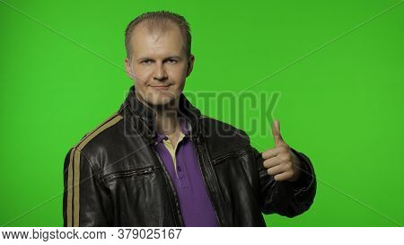 Cheerful Rocker Man Showing Double Thumbs Up And Smiling, Laughing Carefree At Camera, Demonstrating