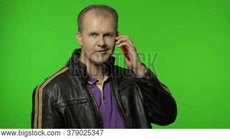 Rocker Man Calling Friend, Talking On Mobile Phone With Proud Expression, Speaking Emotionally A Lot