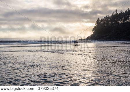 Surfer In Oregon