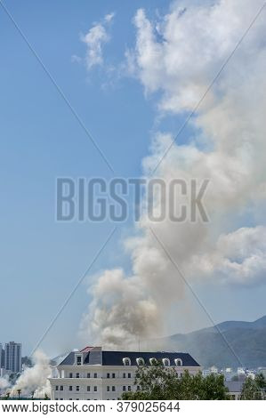 Plume Of Smoke Around The House. Unsafe Danger Situation