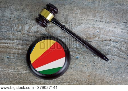 Wooden Judgement Or Auction Mallet With Of Seychelles Flag. Conceptual Image.