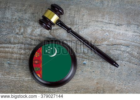 Wooden Judgement Or Auction Mallet With Of Turkmenistan Flag. Conceptual Image.