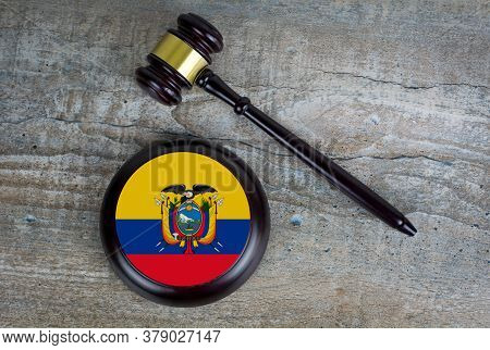 Wooden Judgement Or Auction Mallet With Of Ecuador Flag. Conceptual Image.