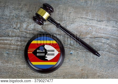 Wooden Judgement Or Auction Mallet With Of Swaziland Flag. Conceptual Image.