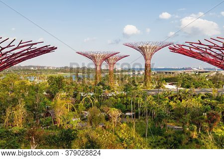 Singapore, Singapore - January 17, 2013. Decorative Towers In Shape Of Tree With Telpherage. Differe