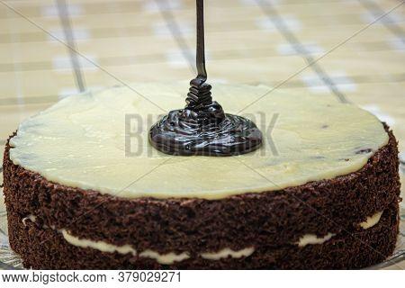 Homemade Chocolate Cake. Cooking The Cake. Decorating The Cake With Chocolate. Liquid Chocolate Is P