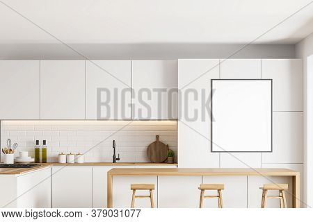 Interior Of Modern Kitchen With White And Brick Walls, White Cupboards And Bar With Stools. Vertical