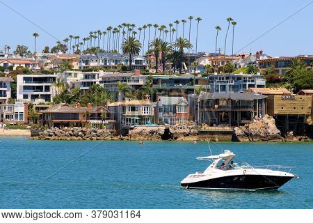 July 30, 2020 In Newport Beach, Ca:  Motor Boat Riding Out To Sea From The Newport Harbor With Resta
