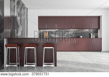 Interior Of Modern Kitchen With White And Marble Walls, Brown Cupboards And Countertops And Bar With
