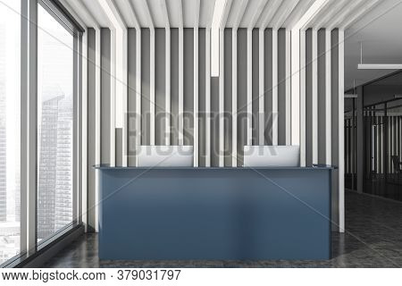 Front View Of Stylish Office Waiting Room With Dark Wooden Walls, Concrete Floor And Gray Reception