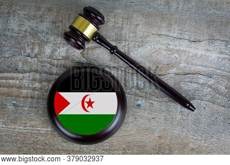 Wooden Judgement Or Auction Mallet With Of Western Sahara Flag. Conceptual Image.