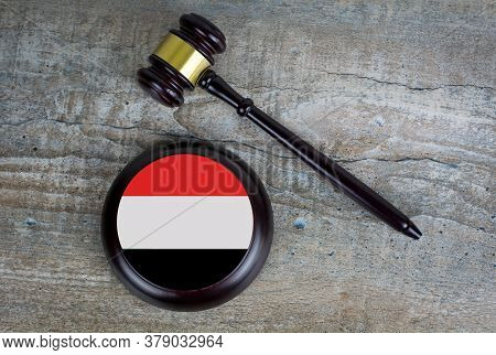 Wooden Judgement Or Auction Mallet With Of Yemen Flag. Conceptual Image.