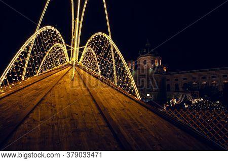 Illuminated Roof Of Christmas Market . Neon Light Illumination . Vienna During Christmas Night