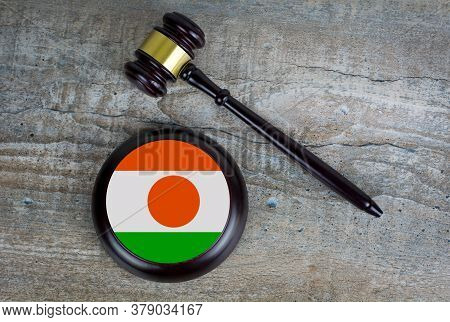 Wooden Judgement Or Auction Mallet With Of Niger Flag. Conceptual Image.