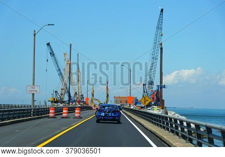 Virginia, U.s.a - June 29, 2020 - The Traffic Passing The Ongoing Construction On Chesapeake Bay Bri