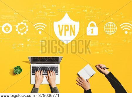 Vpn Concept With People Working Together With Laptop And Notebook