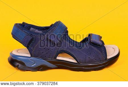 Kids Orthopedic Leather Sandal, Child Shoes. Isolated On Yellow Background.