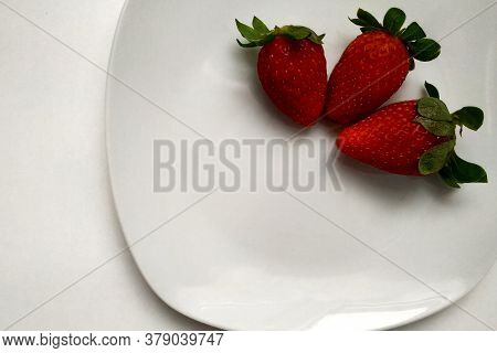 Fresh Homemade Strawberries On A Plate With White Porcelain, Three Juicy Strawberries On A Plate, Gl