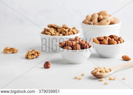 Assorted Nuts. The Dried Nuts, Hazelnuts, Almonds, Walnuts And Others. Healthy Food, Healthy Snacks.