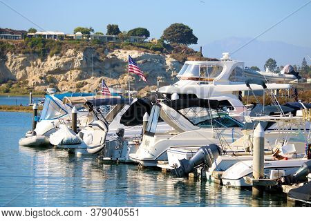 July 31, 2020 In Newport Beach, Ca:  Modern Yachts Docked At The Newport Harbor Which Is Surrounded