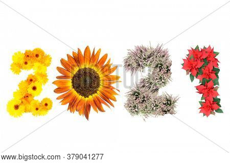 New Year 2021 date arranged from marigold flowers, sunflower, heather and poinsettia representing four season of the year