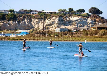 July 31, 2020 In Newport Beach, Ca:  Bluffs Surrounding The Calm Waters Of An Estuary With People Pa