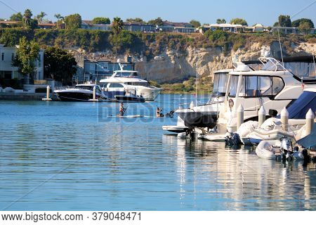 July 31, 2020 In Newport Beach, Ca:  Docked Boats On The Newport Harbor Surrounded By Bluffs Where P