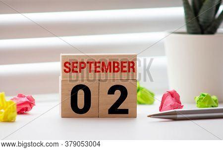 September 2. Date Of September Month. Diamond Wood Table For Background.