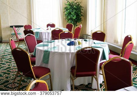 Dinner Tables And Chairs In The Banquet Hall