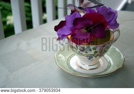 A Beautiful Tea-cup Feminine Centerpiece With Pansies.